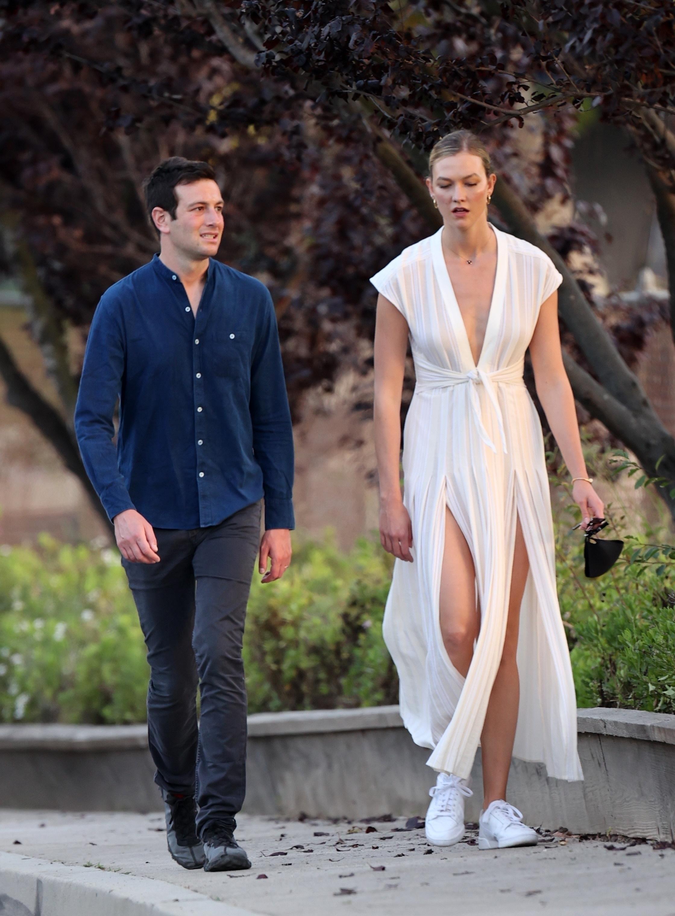 Karlie Kloss and hubby Joshua Kushner enjoy a romantic walk together