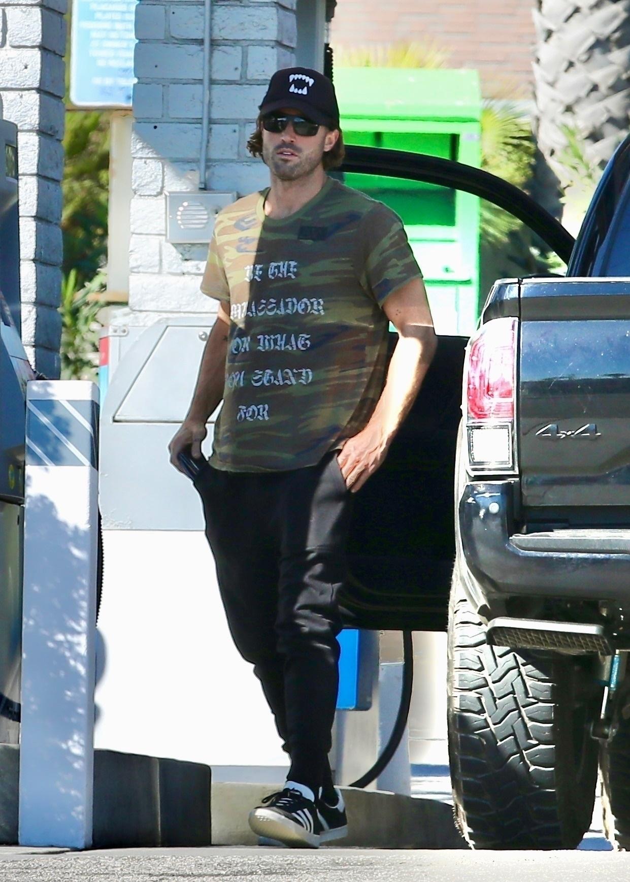 Brody Jenner pumps gas in Malibu