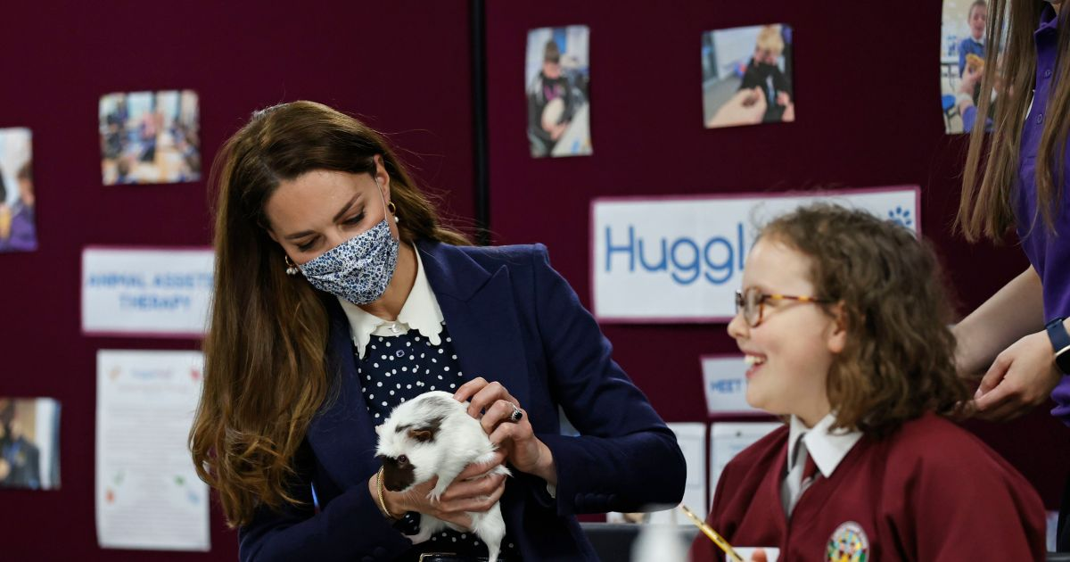 Duchess Kate plays with a guinea pig, more royals with cute animals.jpg